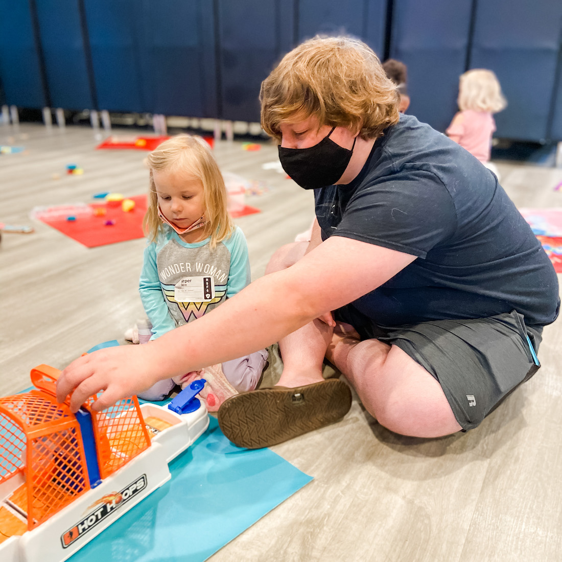 simple-church_west-des-moines_child-with-volunteer.jpg