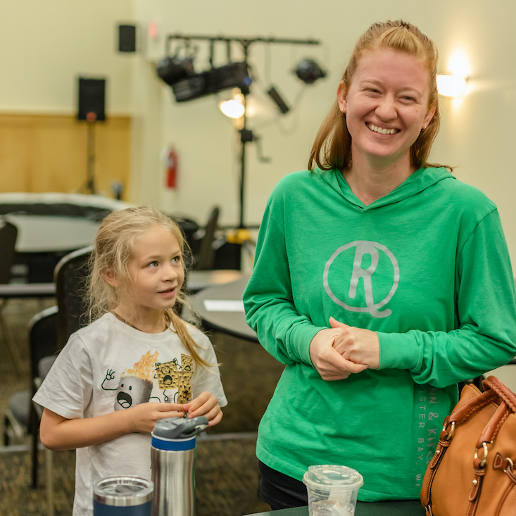 simple-church_west-des-moines_women-smiling-with-kid.jpg